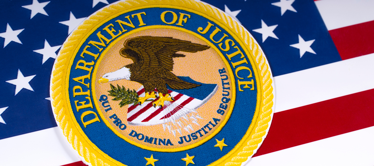 Department of Justice Seal over the American Flag